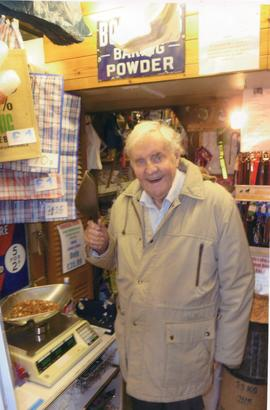 Richard Briers buying pet food in Bampton