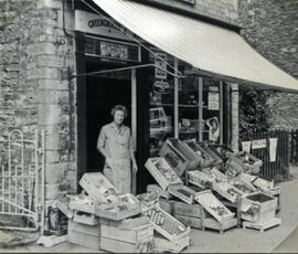 Mrs Clark in her shop doorway, High Street