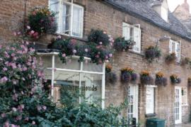 Hanging baskets outside Adrian Simmonds' Store 1983 & 1984