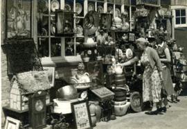Mr & Mrs Hill & son Arthur Hill's antique cum bric-a-brac shop in Bridge Street